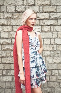 beautiful fashion woman against a stone wall