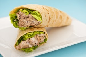 Two tuna melt wrap on a white plate